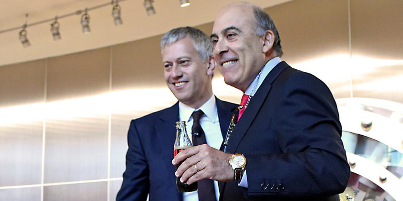 New Coke CEO James Quincey and former CEO Muhtar Kent pose at the Coca-Cola Company's annual meeting.