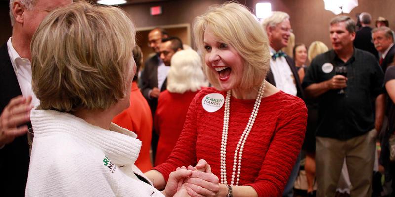 Karen Handel supporters celebrate her rising poll numbers.