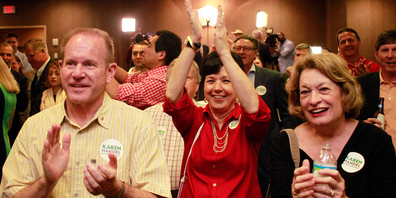 Karen Handel supporters cheer election returns that indicate a June 20 runoff against Jon Ossoff.