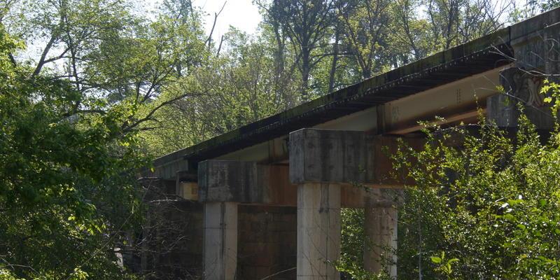 A fire broke out under railroad tracks near Chesire Bridge Road Thursday morning.