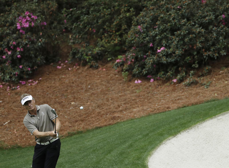 Bernhard Langer of Germany hits on the 13th hole during a practice round Wednesday for the Masters golf tournament in Augusta. Augusta National's colorful, blooming azaleas were mostly missing this year.