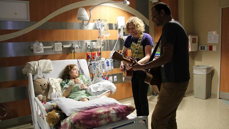 Songs for Kids Foundation founder Josh Rifkind and Sanjay Kothari serenade a patient.