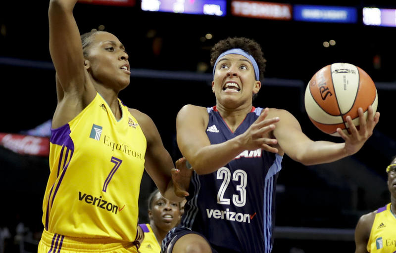 Layshia Clarendon of the Atlanta Dream (right) is active off the court with broadcasting work and as an advocate for LGBT athletes.