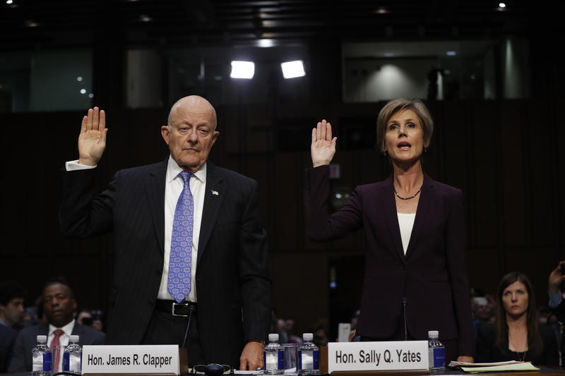 Former acting Attorney General Sally Yates and former National Intelligence Director James Clapper are sworn-in on Capitol Hill in Washington, Monday, May 8, 2017, prior to testifying.