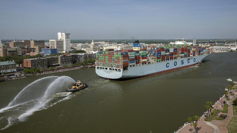 The container ship COSCO Development sails up river Thursday past Savannah's historic district to the Port of Savannah.