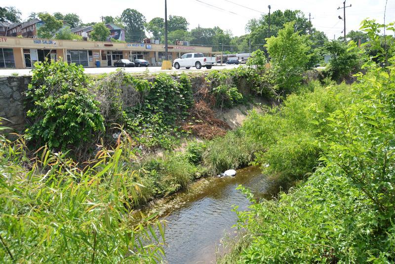 Proctor Creek passes through businesses and apartments along Joseph E. Boone Blvd.