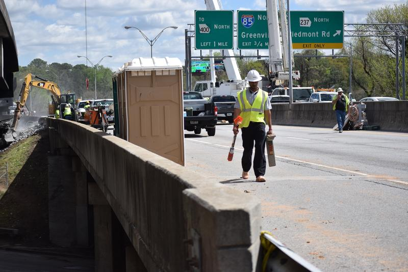 Businesses around the I-85 bridge site have been struggling. Some have seen their sales cut in half.