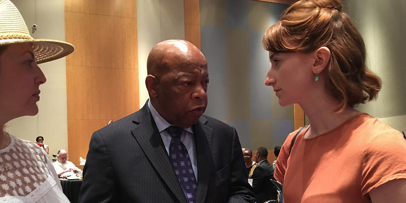 Rep. John Lewis (center) talks to Jacqueline Guzman (left) and Skylar Denney at his meet-and-greet event.