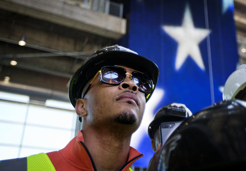 Rapper T.I. tours the Mercedes-Benz Stadium, the new stadium for the Atlanta Falcons NFL football team under construction in Atlanta, last month. In a recent interview, T.I. spoke about his social justice efforts and upcoming music.