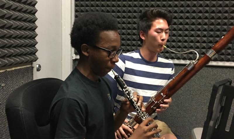 Mekhi Gladden (foreground) and Christopher Chung perform a duet in WABE's studio.