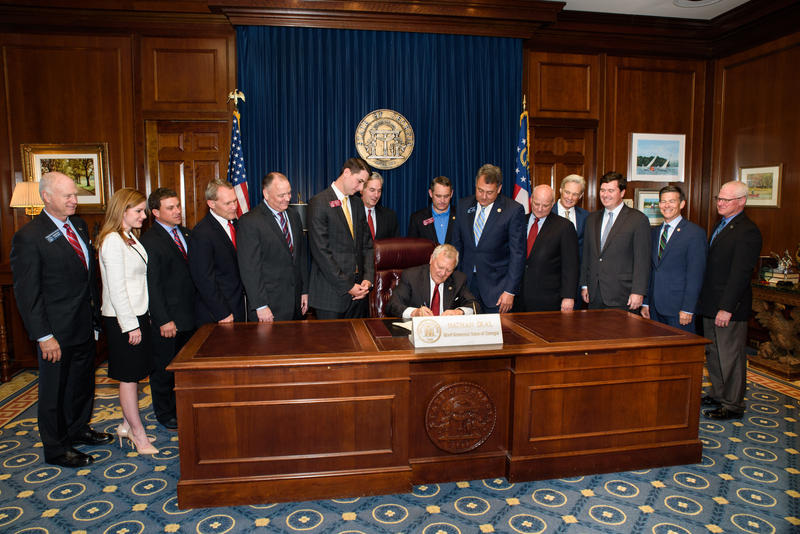 Governor Nathan Deal signs Senate Bill 219 on Monday, allowing for self-driving cars on Georgia roads.