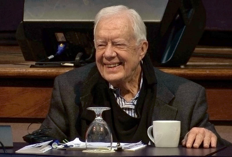 Former President Jimmy Carter speaks Tuesday at the annual Human Rights Defenders Forum at the Carter Center in Atlanta. He said he is working on a book that will be finished this year.