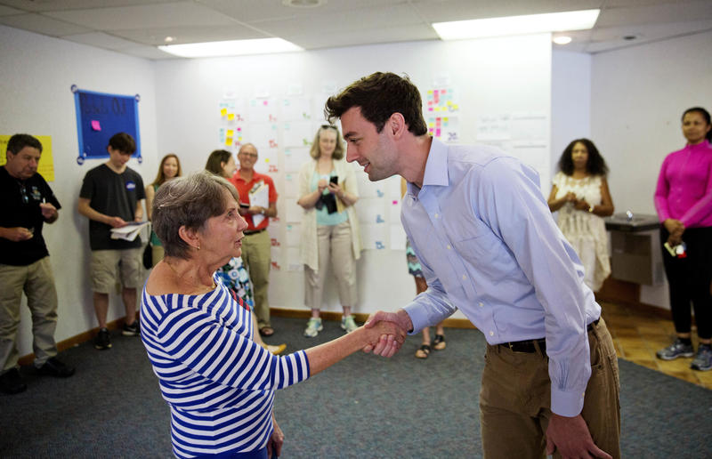 Volunteer Harriet Zoller greets Jon Ossoff, the 30-year-old Democrat running for Congress in Georgia's traditionally conservative 6th Congressional District at his campaign office in Sandy Springs.
