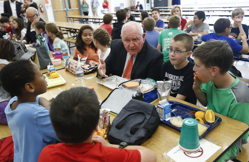 Agriculture Secretary Sonny Perdue has lunch Monday with students at Catoctin Elementary School in Leesburg, Virginia, after he unveiled a new rule on school lunches.