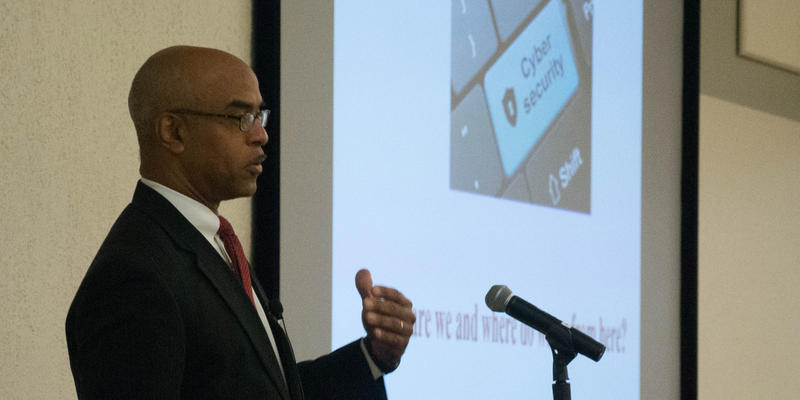 Attorney Roy Hadley speaks at  Technology Association of Georgia's cybersecurity simulation training at Kennesaw State University.