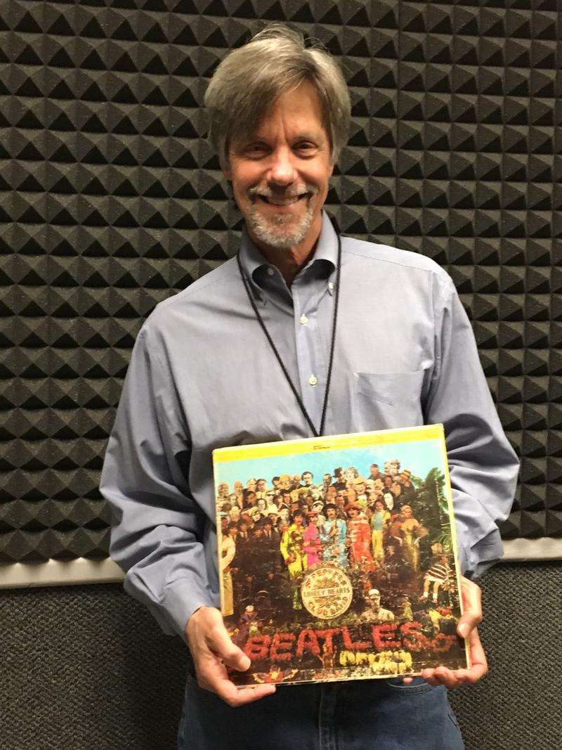 "Steve Goss with the copy of the Beatles' ""Sgt. Pepper"" album. It has been called one of the greatest albums of all time."