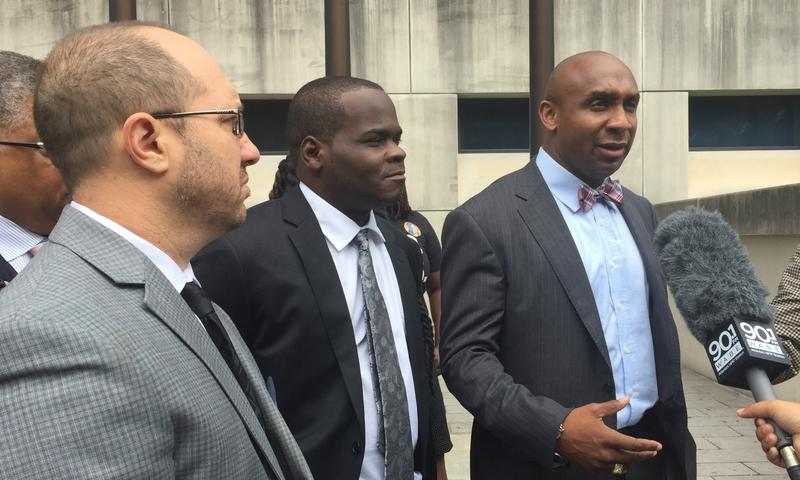 I-85 bridge fire suspect Basil Eleby (center) and his attorney Mawuli Davis (right) talk to the media after Friday's hearing at the Fulton County Courthouse.