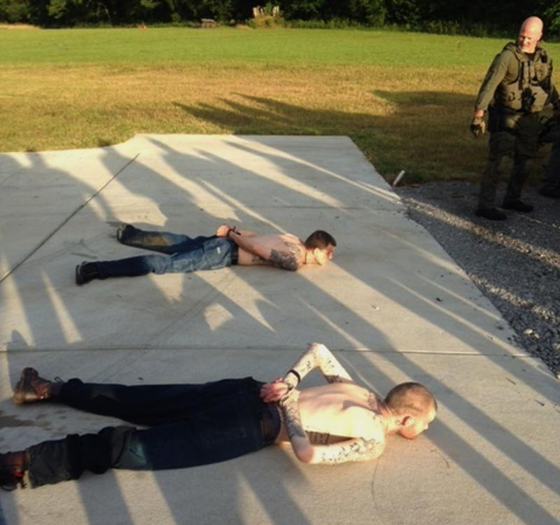 This photo shows the arrest of two Georgia fugitives -- Donnie Rowe, top, and Ricky Dubose – last month in Christiana, Tennessee.