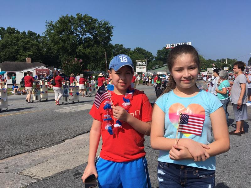 Eleven-year-old Brian Toriz and his younger sister Ailin Toriz celebrate the Fourth of July at the City of Marietta's historic downtown square on Tuesday.