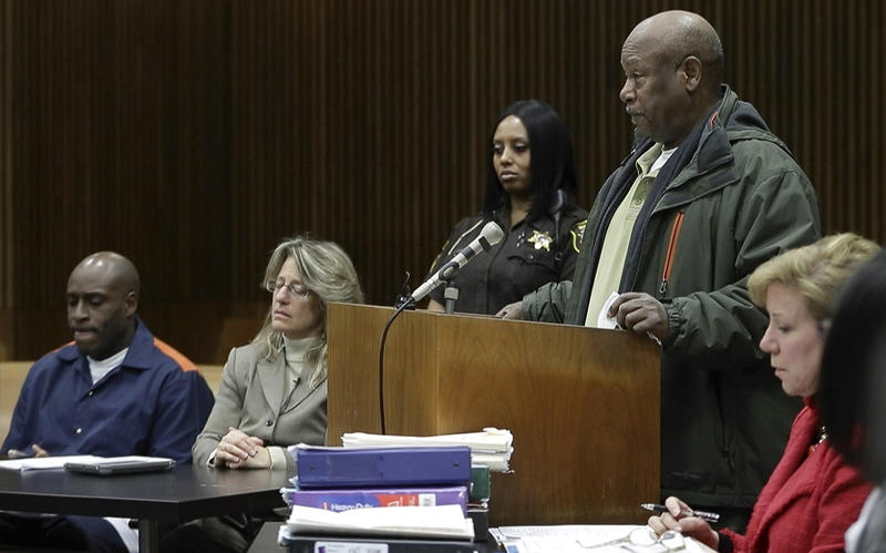 "Henry Carpenter Warren Jr. addresses the court on March 16 during a resentencing hearing for his son's killer, Bobby Hines, seated left, in Detroit. Warren says Hines ""was punished excessively. ... He can go home today."""