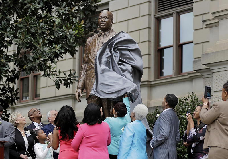 A statue paying tribute to civil rights leader Martin Luther King Jr. is unveiled on the state Capitol grounds in Atlanta on Monday.