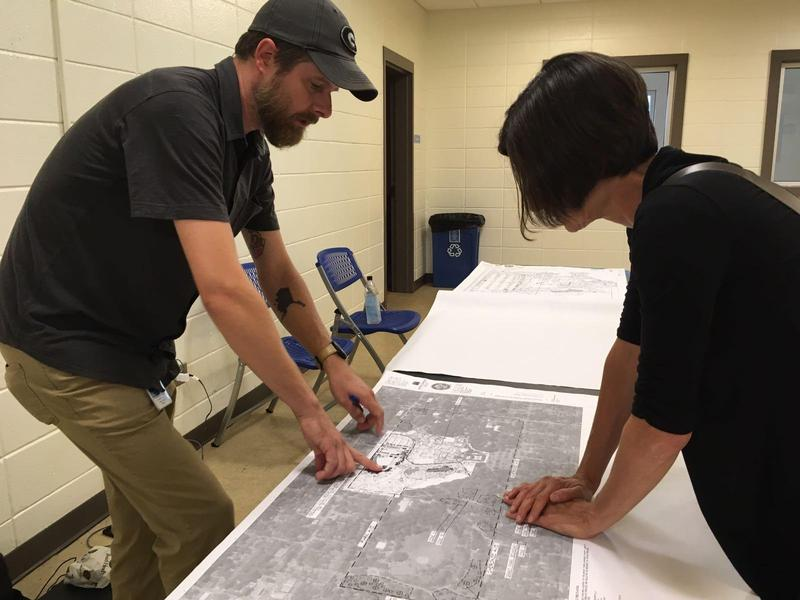 Chris Kallio, an arborist with the city of Atlanta's Office of Parks, explains where trees are being removed to an open house visitor on Wednesday.