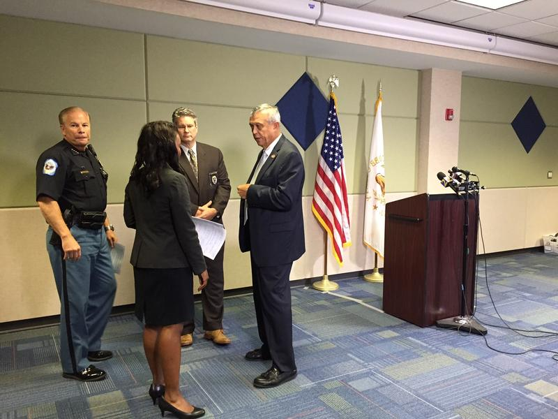Cobb County officials are shown Thursday before a press conference to address racial remarks made by an officer during a traffic stop.