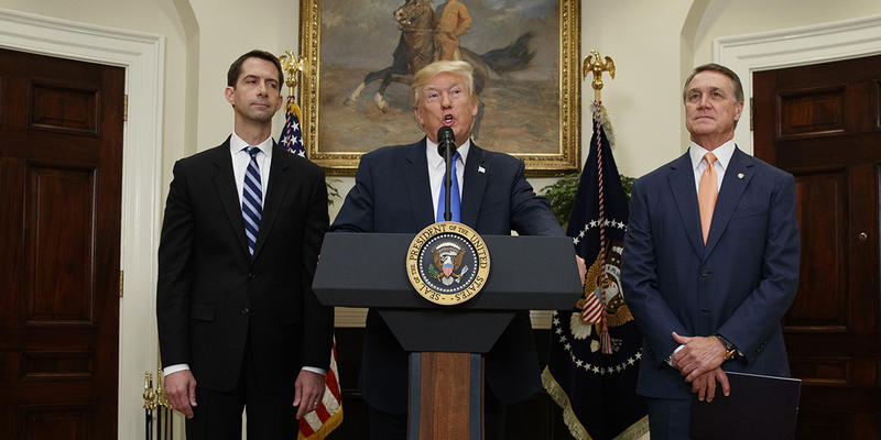 President Donald Trump, flanked by Sen. Tom Cotton, R- Ark., left, and Sen. David Perdue, R-Ga., speaks in the Roosevelt Room of the White House during the unveiling of legislation that would place new limits on legal immigration.