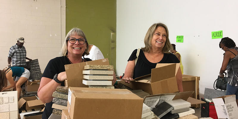 Teachers MaryJo Mulvey and Catherine Woodruff show off some of their carts filled with all sorts of supplies during ZeroLandfill.