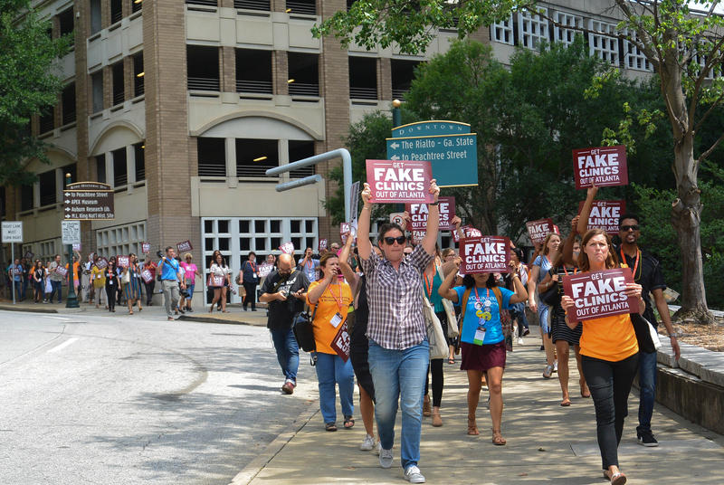 Abortion rights demonstrators on Saturday protested pregnancy centers that discourage people from following through with their abortions plans.