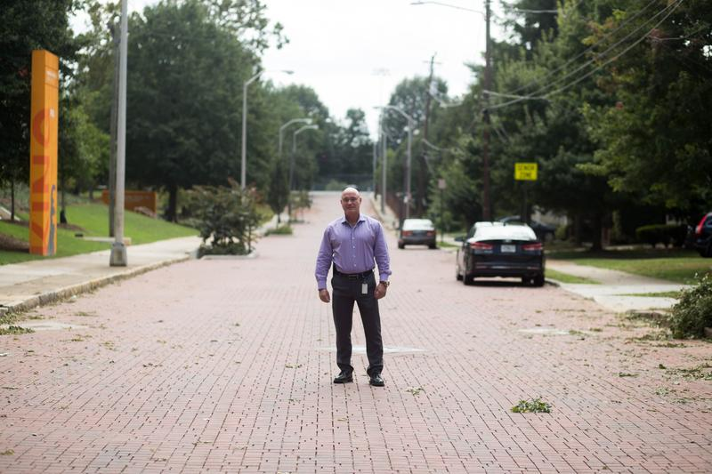 Todd Hill, with Atlanta Department of Watershed Management, stands on a street of permeable pavers in Summerhill.