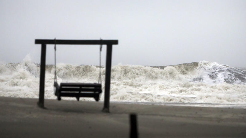 Waves on the southend beach of Tybee Island pound the beach as Tropical Storm Irma heads into the state on Monday. Many residents from Georgia's coast, as well as Florida, evacuated to Atlanta. For now, officials are telling them to stay there.