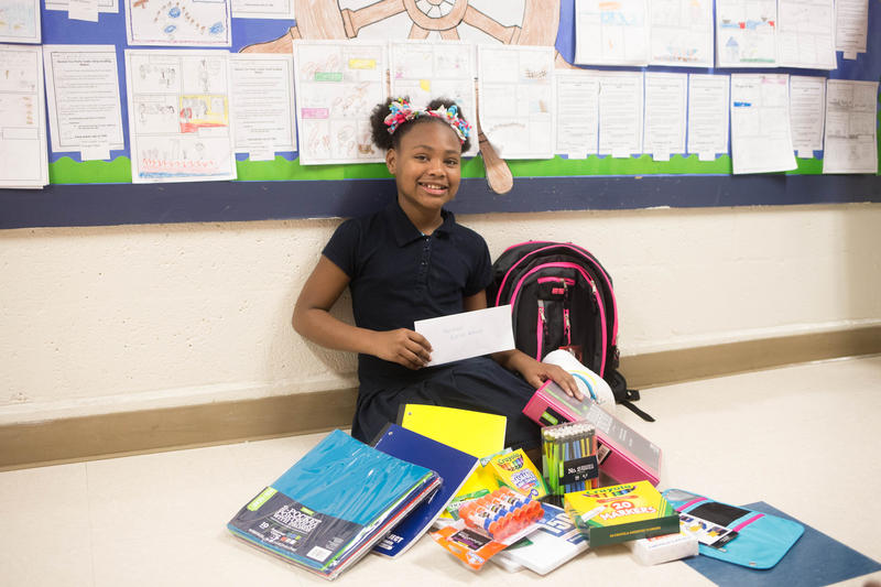 Slater fifth-grader LyNila Cain received a bookbag full of school supplies and a $100 Walmart gift card for her actions.
