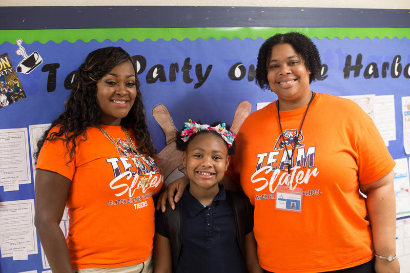 LyNila poses with her math teacher, Victoria Robinson (left) and Slater Principal Lenise Bostic (right).