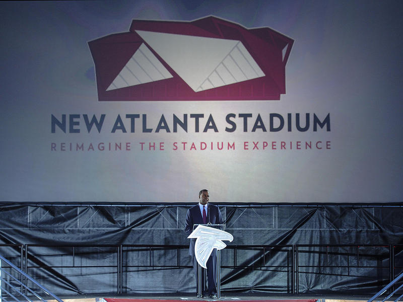 Atlanta Mayor Kasim Reed speaks during the ground breaking ceremony for the new stadium to be the home of the Atlanta Falcons, and the new Atlanta Major League Soccer team franchise, held Monday, May 19, 2014, in Atlanta. (AP Photo/John Amis)