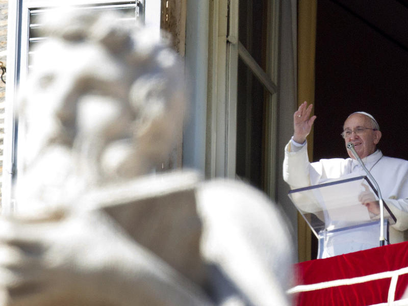 In this Sunday, March 8, 2015 file photo, Pope Francis recites the Angelus noon prayer from his studio window overlooking St. Peter's Square at the Vatican.