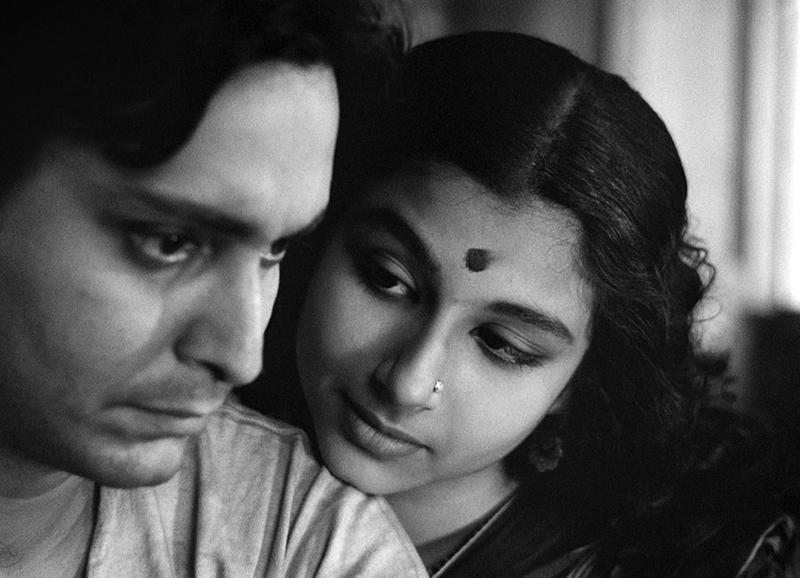 "Soumitra Chatterjee as Apu and Sharmila Tagore as Aparna (Apu's wife) in the film, ""Apur Sansar,"" part of the Apu film trilogy by Bengali director Satyajit Ray."