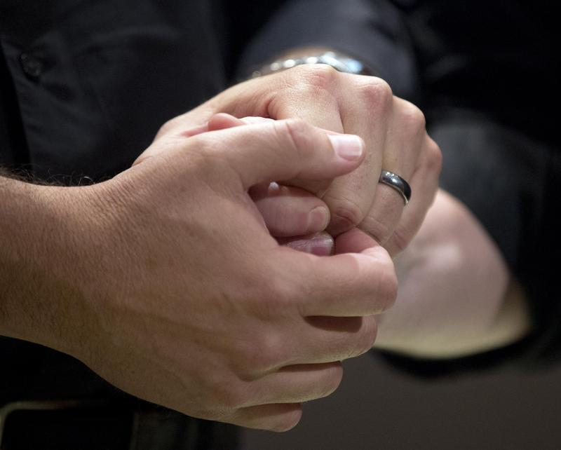 Ed Cieslak and Richard Moye hold hands as they are married in a mass wedding at Fulton County Government Center Friday June 26, 2015