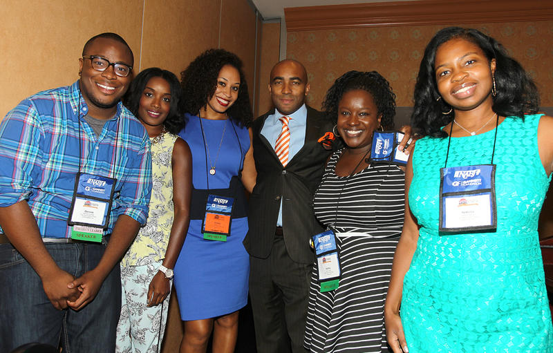 Gerrick Kennedy left, Arienne Thompson, Hillary Crosley, Lee Hawkins, Kelley L. Carter and Nekesa Moody pose for a photo before a panel during the NABJ 2013 Convention, on Thursday, August 1, 2013 in Orlando, Florida.