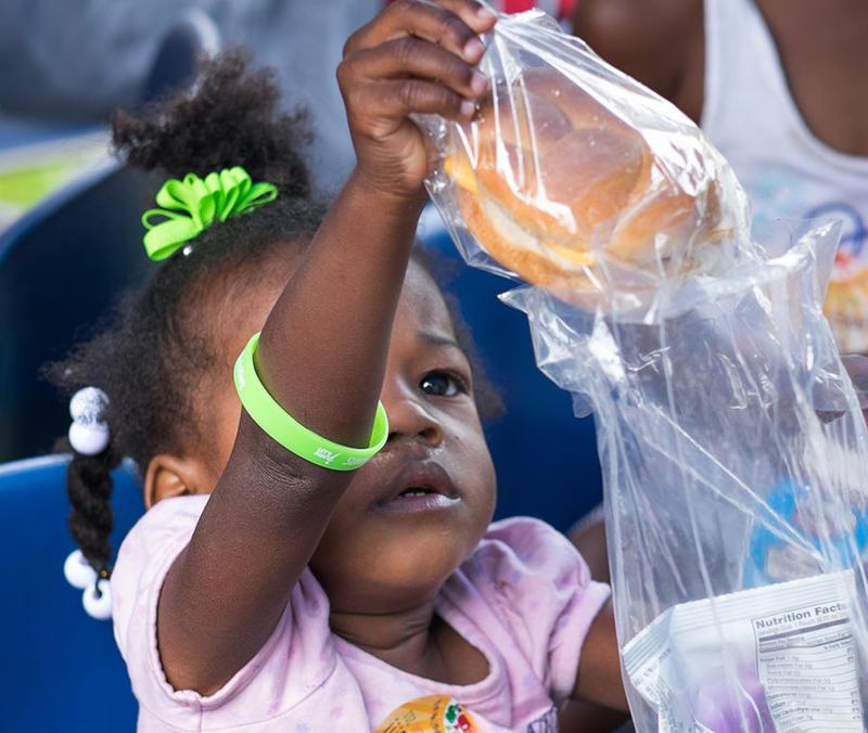 Patrons at a summer meal kickoff event for the Atlanta Food Bank