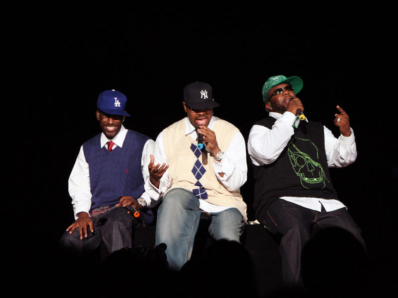 From left to right: Shawn Stockman, Nathan Morris, and Wanya Morris, better known as the Boyz II Men, singing amongst onlooking audiences at their concert in Genting Highlands, Malaysia on January 2007