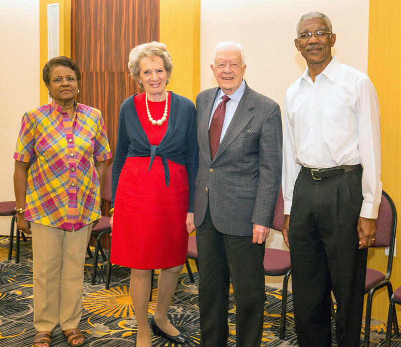 Former President Jimmy Carter stands with the co-leaders of his election delegation, (l-r) Dame Billie Miller of Barbados and Dame Audrey Glover of the United Kingdom and David Granger, candidate for President of Guyana, Sunday, May 10, 2015.