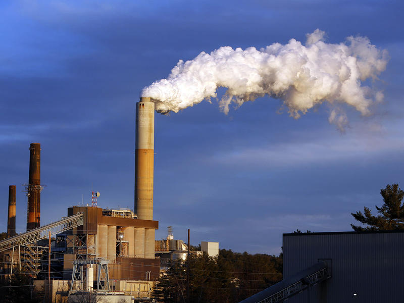 In this Jan. 20, 2015 file photo, a plume of steam billows from the coal-fired Merrimack Station in Bow, N.H. President Barack Obama presented his final plan for carbon dioxide reduction targets on Monday, Aug. 3, 2015, which would reduce emissions.