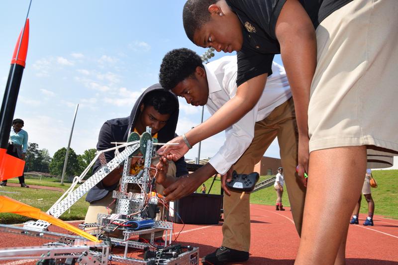 Joshua Koonce, Delante Jordan and Michael Slator Jr (l-r) put the finishing touches on the rocket pad.