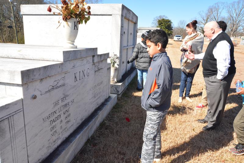 Ezekiel Teffer looks at the King family grave in South-View Cemetary