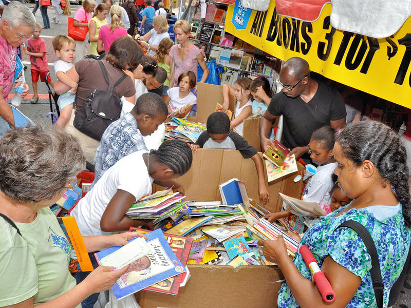 The 2011 Decatur Book Festival crowd sifts through boxes of books