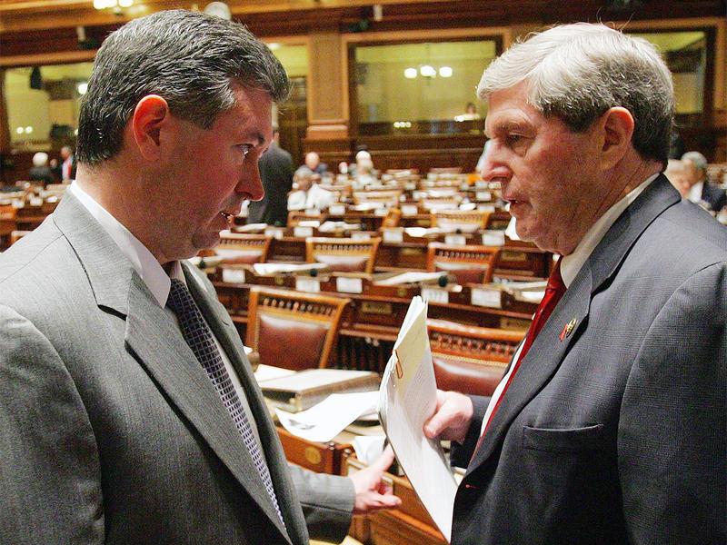 Speaker of the House Glenn Richardson, R-Hiram, left, speaks with Rep. Harry Geisinger, R-Roswell, on the floor of the House at the Capitol in Atlanta,