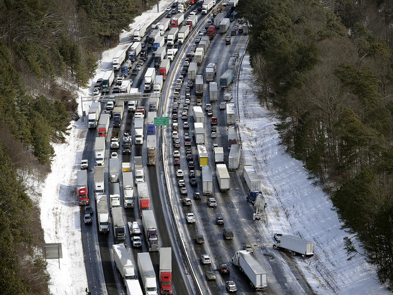 In this aerial photo, traffic is snarled along the I-285 perimeter north of the metro area after a winter snow storm, Wednesday, Jan. 29, 2014, in Atlanta.