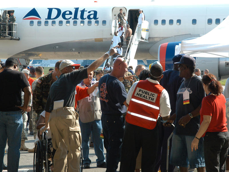 Marietta, GA, September 4, 2005 -- New Orleans Katrina evacuees arrive at Dobbins AFB and begin the security admittance process at the check point. Immediate medical assistance is available here and those able to go to shelters will receive a general heal