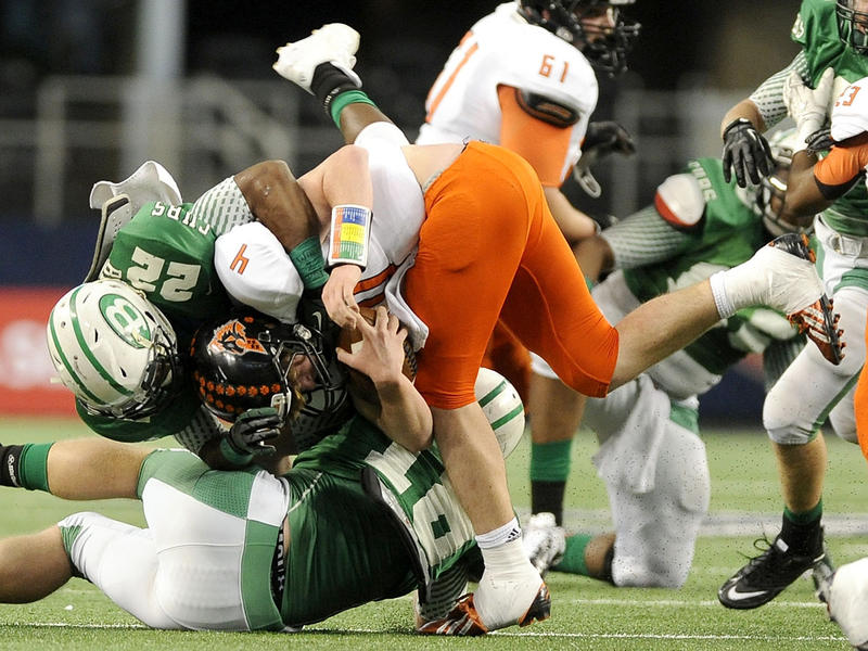In this Dec. 21, 2013 file photo, Aledo quarterback Luke Bishop (4) is tackled by Brenham's Ryan Nunn (22) in the first half during the UIL Class 4A, Division II high school football championship game in Arlington, Texas.